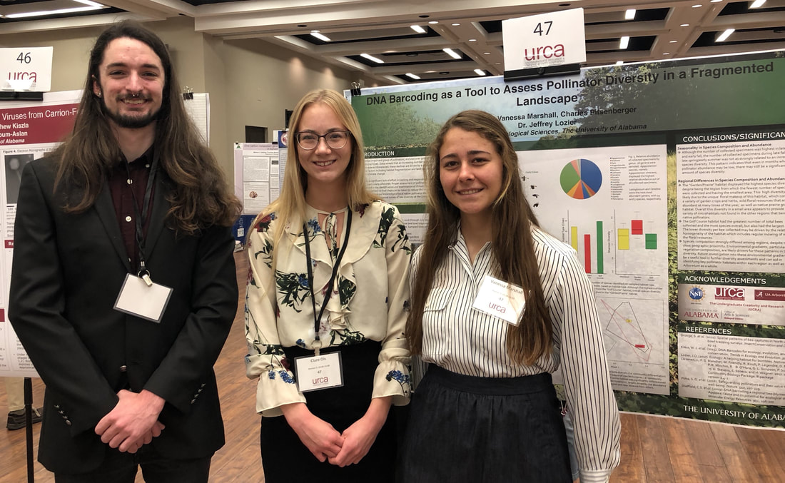 Clare, Charles, and Vanessa present their poster